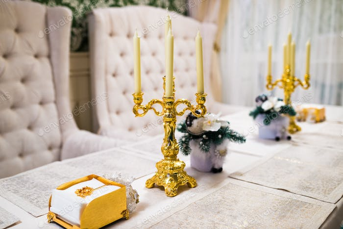 Festive table with menu, candles and decorations for New Year party celebration