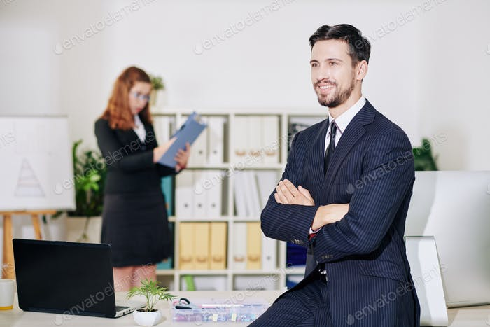 Smiling confident businessman