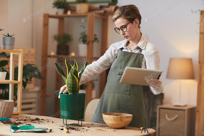 Modern Young Woman Watching Gardening Tutorials