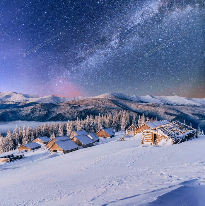 chalets in the mountains at night under the stars