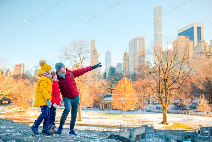Family of father and kids in Central Park during their vacation in New York City