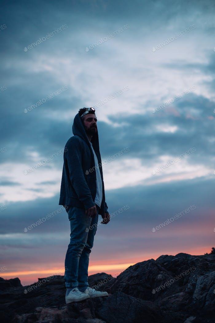 Adventurer traveler with headlight on sunset