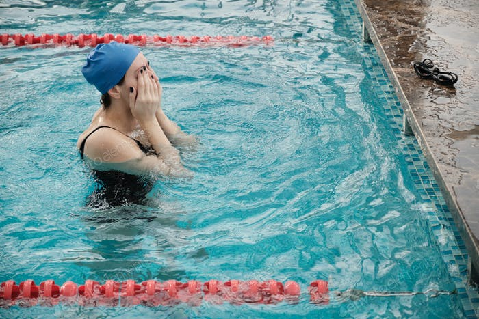 Rubbing eyes in swimming pool