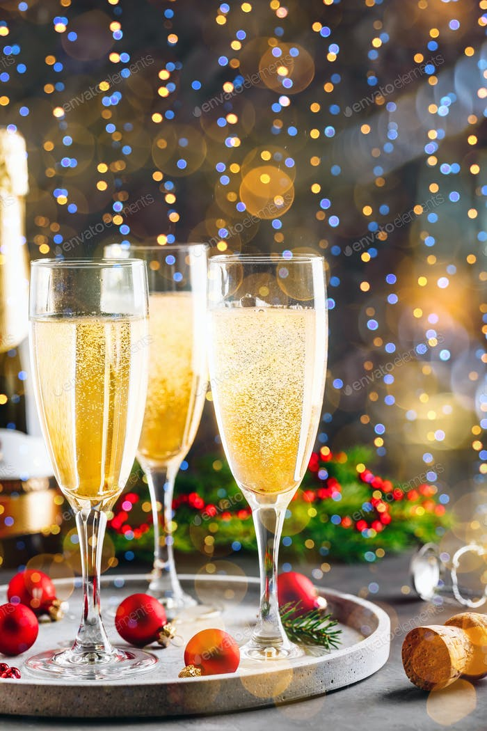 Glasses of champagne or prosecco over blur spots lights background.