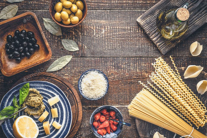Ingredients of Italian cuisine on the wooden table top view