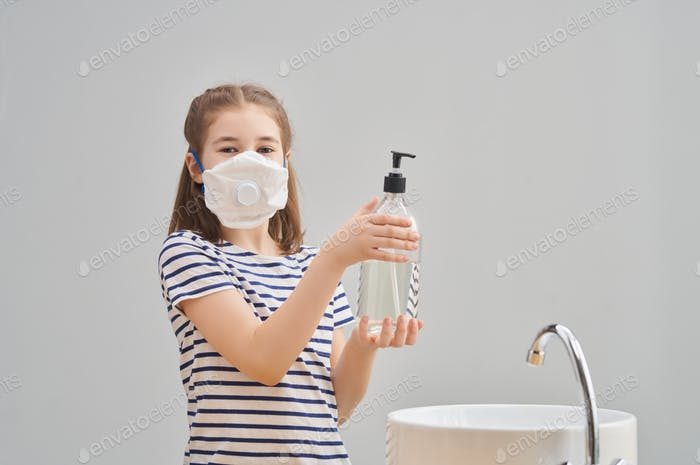 Girl is wearing face mask and washing hands