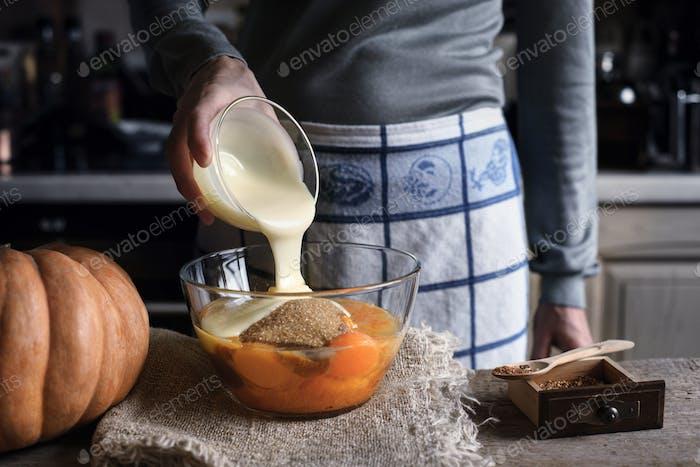 Adding condensed milk in the dough for pumpkin dump cake