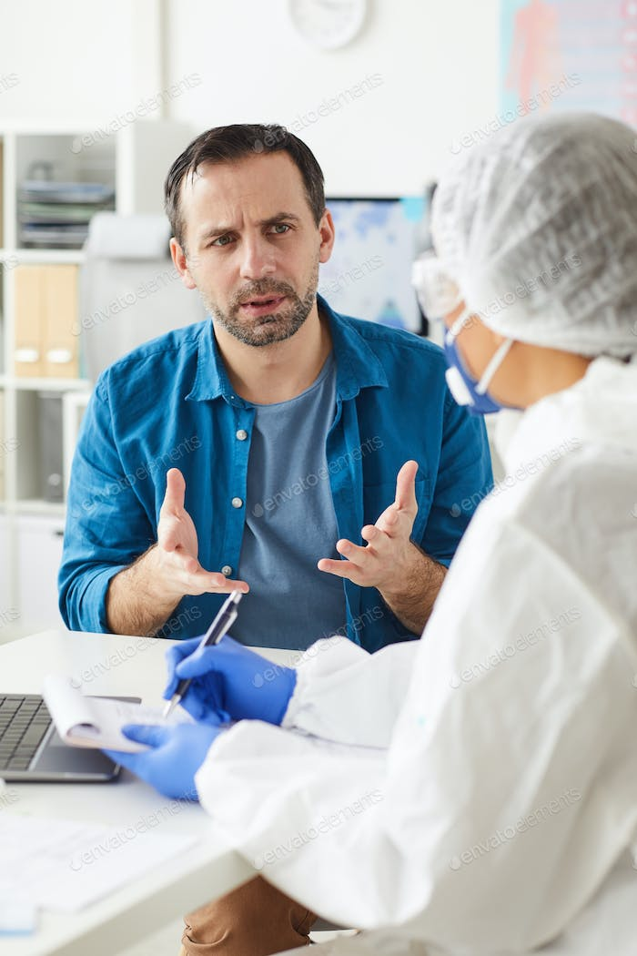 Patient discussing his illness with doctor