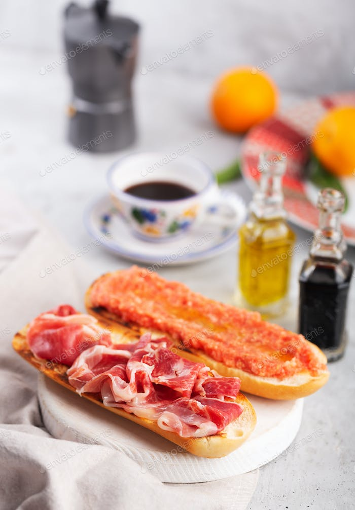 Spanish tomato and ham toast, traditional breakfast or lunch with coffee