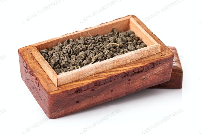Green tea in a wooden box