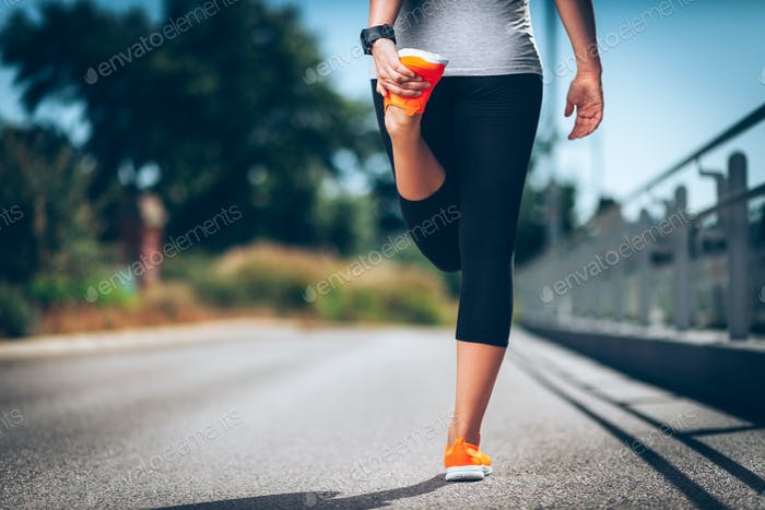 City workout. Beautiful woman with a smartwatch training in an urban setting