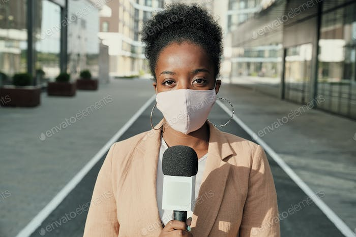 African reporter in mask
