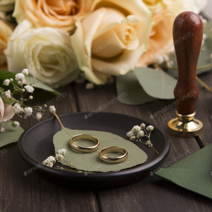 Close up of golden pair of wedding rings on plate