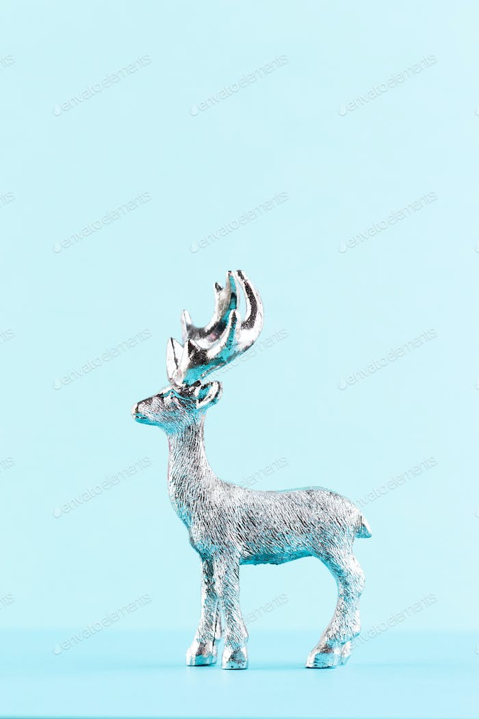 Christmas reindeer on pastel color background.