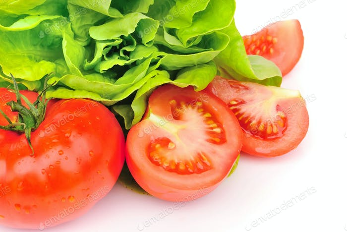 Fresh tomatoes and green salad isolated on white background