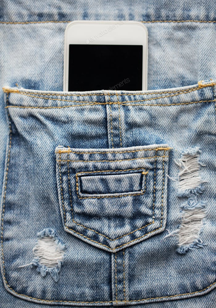smartphone in pocket of denim overalls