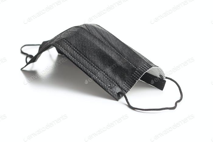 Corona virus protection. Black medical paper face mask