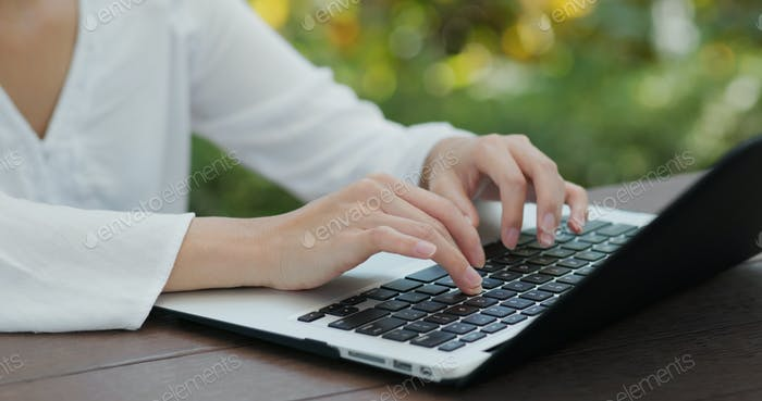 Type on laptop computer at outdoor