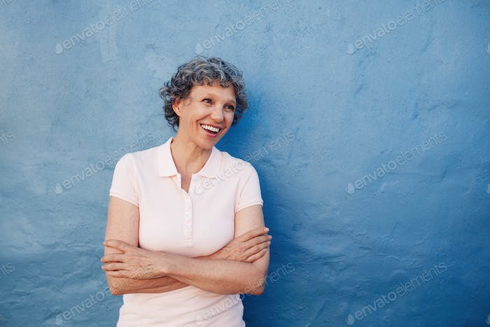 Senior woman looking happily at copy space