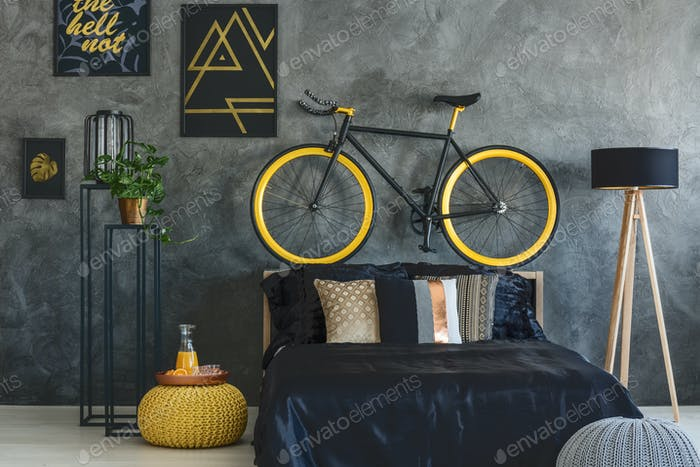Trendy bedroom with wall posters