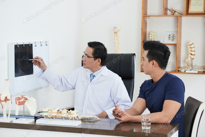 Osteopath talking to patient