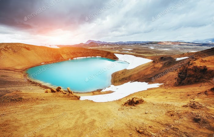 Giant volcano overlooks. Turquoise provides a warm geothermal wa