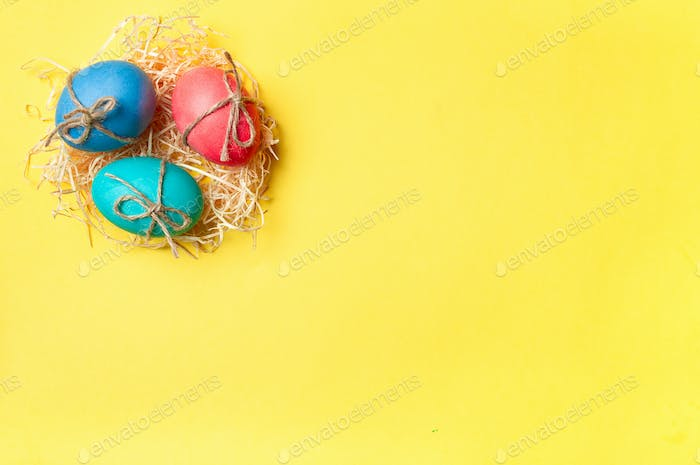 Easter concept, copy space, top view, yellow background