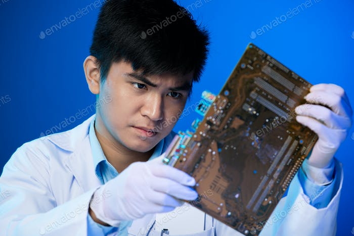 Engineer with circuit board