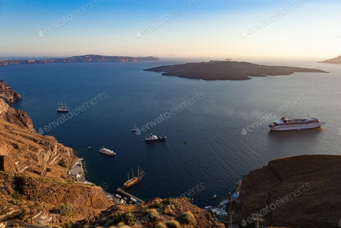 Oia caldera over Aegean sea at sunset, Santorini island.