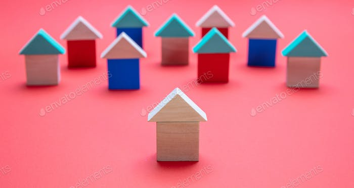 One house model ahead of the others, red color background