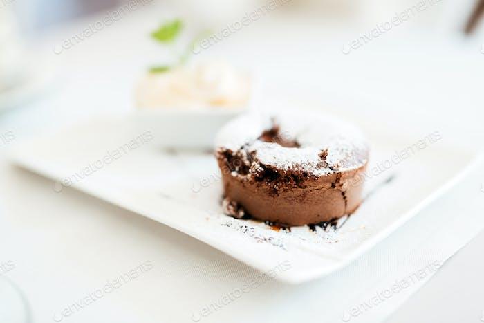 Beautiful souffle and vannila ice cream in modern restaurant
