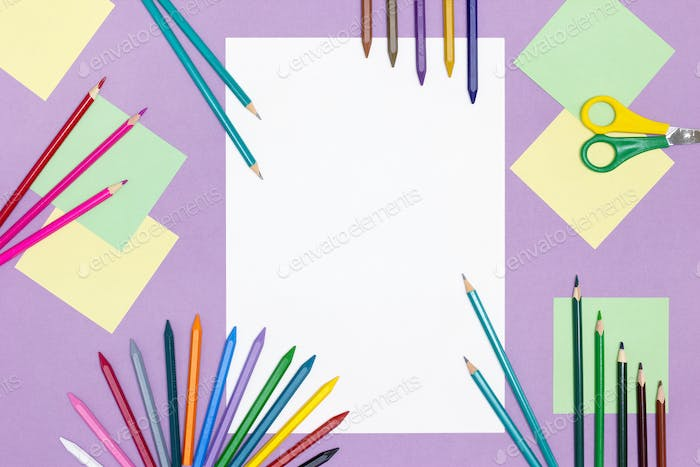 Blank paper, bright colored pencils, scissors on the table