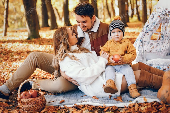 Beautiful and stylish family in a park