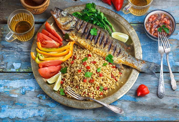Grilled sea bass on coper plate, moroccan style