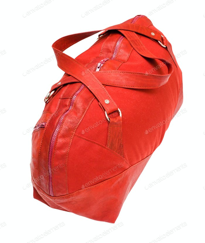 above view of red travelling bag isolated