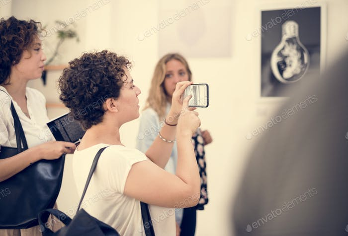 people checking out the exhibition