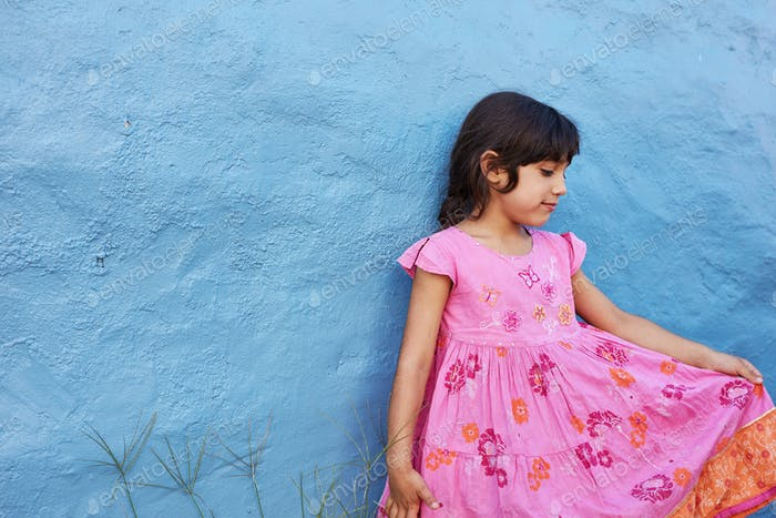 Little girl in beautiful pink dress