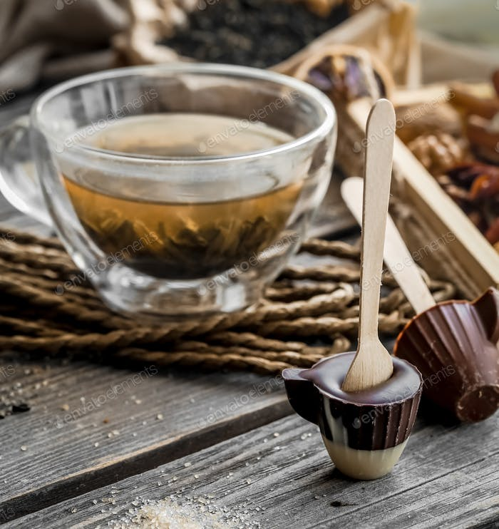 tea and chocolate candy on a stick