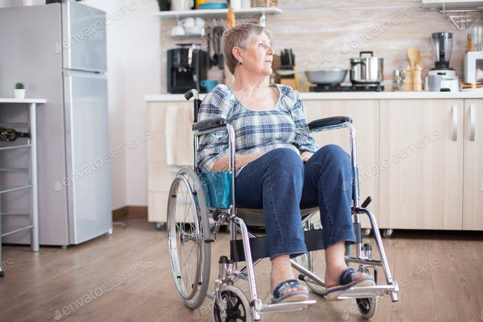 Depressed handicapped woman in wheelchair