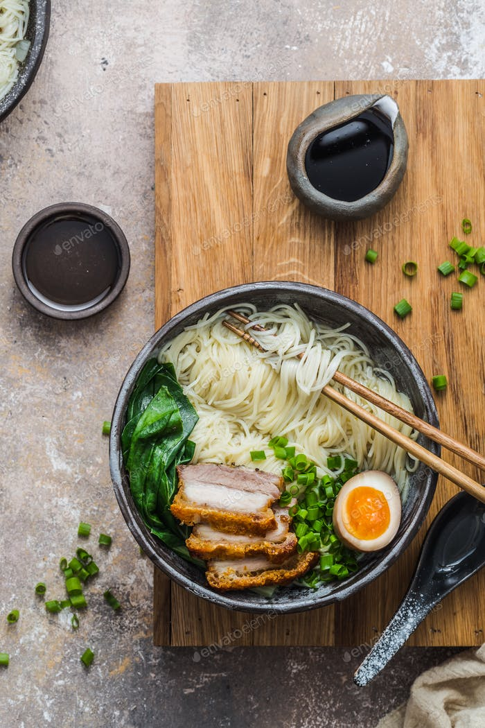 Close view ramen noodles with pork and egg