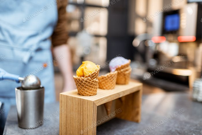 Ice cream in waffle cone on a store counter