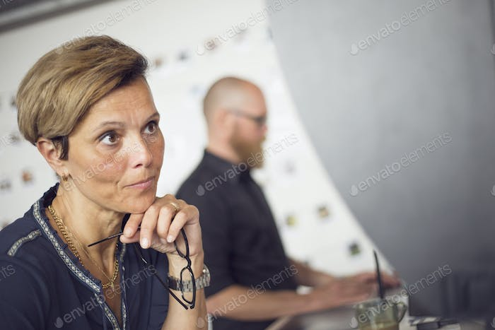 Man and woman working at office