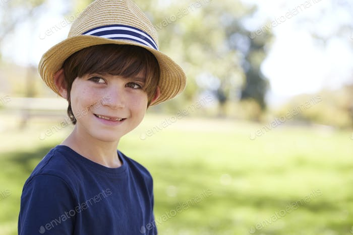 Young schoolboy in a sun hat smiling, close up portrait