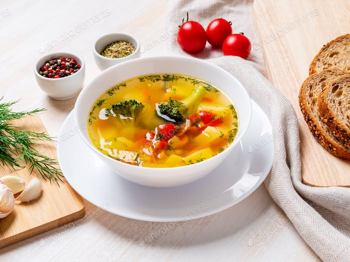 Healthy bright spring vegetable dietary vegetarian soup with broccoli, side view