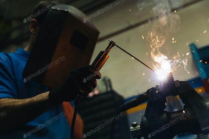 Professional Mechanic welding.