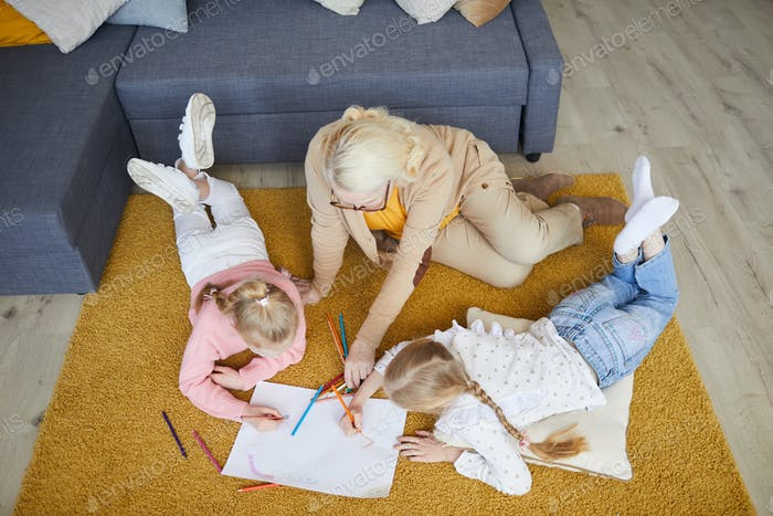 Grandmother drawing with children