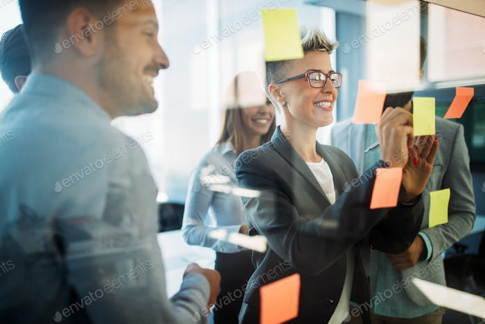 Business people planning strategy in office together