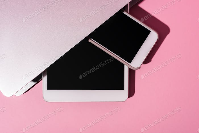 Top View of Gadgets on Pink Background