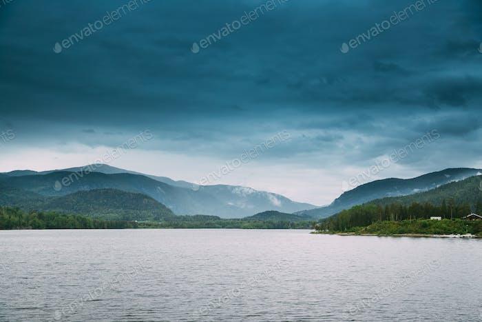 Norway. Beautiful Lake Kroderen In Summer Cloudy Day. Norwegian