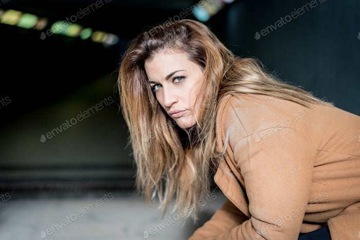 young thoughtfull woman on the street
